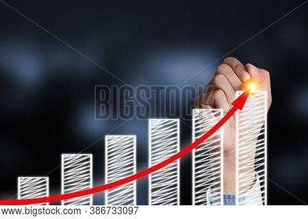 Businessman Writing Increase Red Arrow On Bar Chart.business Investor Concept And Profit Rise Up.