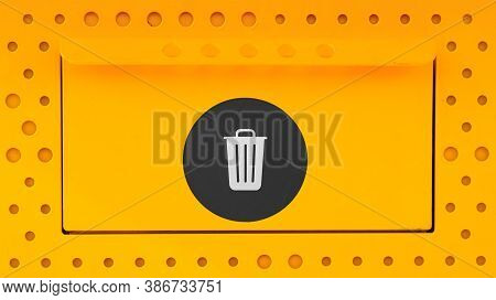Yellow Trash Can Close-up With A Black Sticker On The Lit. Garbage Bin Opeing Wit Ha Closed Lit On A