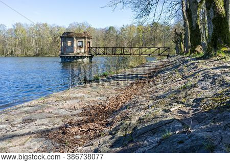 Turret With A Shutter On A Forest Pond, An Old Abandoned Structure On A Pond, Vilgeiten Pond, Koloso