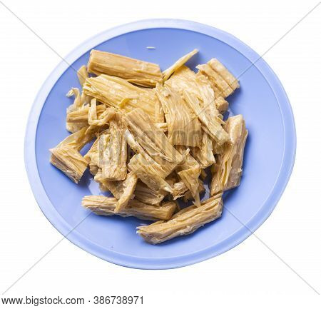 Soy Asparagus Noodles On Light Blue Plate, Isolated On A White Background. Healthy Food . Asian Food