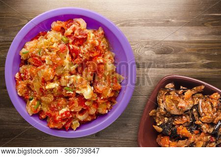Stewed Tomatoes With Onions In Purple Plate On Brown Wooden Background. Stewed Tomatoes With Onion T