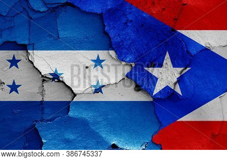 Flags Of Honduras And Puerto Rico Painted On Cracked Wall