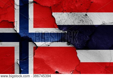 Flags Of Norway And Thailand Painted On Cracked Wall