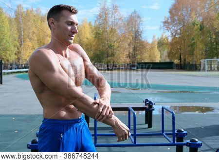 Sporty Toned Caucasian Man Of Middle Age Doing Warm Up Exercises Before Workout. Positive Shirtless