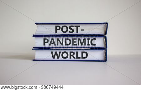 Books With Text 'post-pandemic World' On Beautiful White Background. Business And Covid19 Post-pande