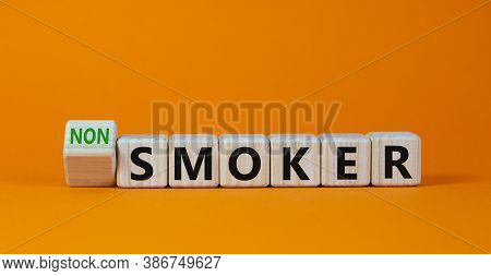 Turned A Cube And Changed The Expression 'smoker' To 'non Smoker'. Beautiful Orange Background. Stop