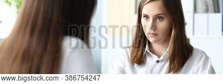 Portrait Of Pretty Businesswoman Looking At Colleague Seriously And Discussing Important Business Co