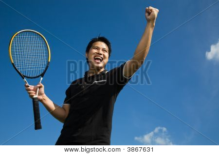 Asian Tennis Player In Joy Of Victory