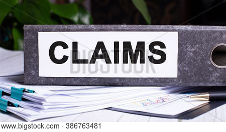 Claims Is Written On A Gray File Folder Next To Documents. Business Concept