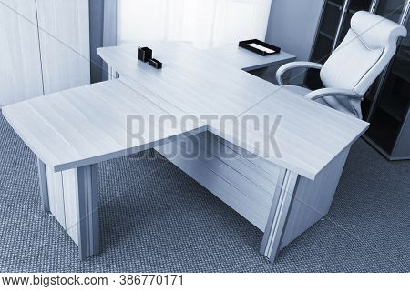 white and a large table in a modern office