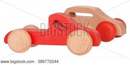 Red and beige wooden toys cars isolated on white background