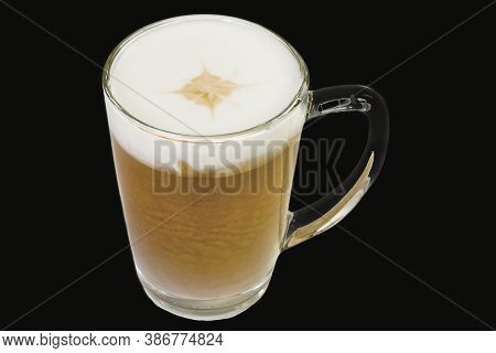 Tasty Barista Coffee Macchiato In A Glass,  Isolated On Black Background