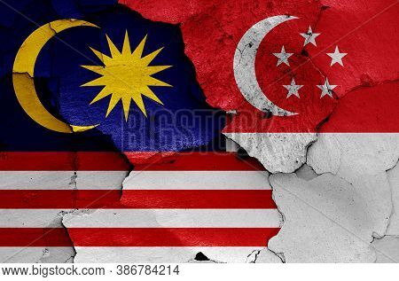 Flags Of Malaysia And Singapore Painted On Cracked Wall