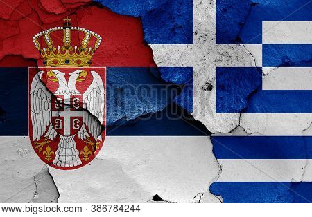 Flags Of Serbia And Greece Painted On Cracked Wall