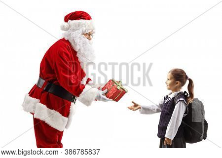 Santa Claus giving a sparkly present to a schoolgirl isolated on white background