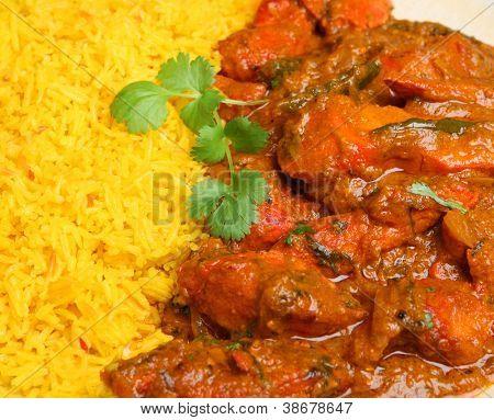 Indian chicken tikka jalfrezi curry with pilau rice.