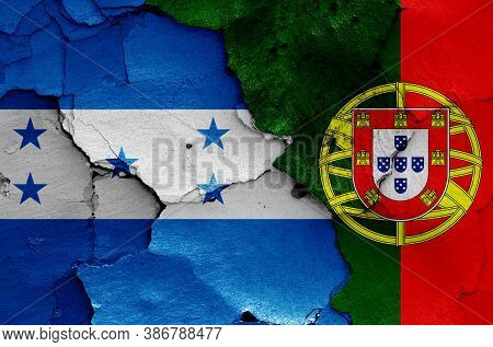 Flags Of Honduras And Portugal Painted On Cracked Wall