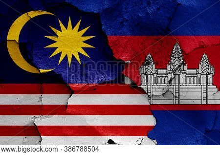 Flags Of Malaysia And Cambodia Painted On Cracked Wall