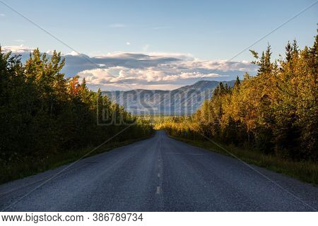Scenic Road View Of Klondike Hwy During A Sunny And Colorful Sunset. Taken North Of Whitehorse, Yuko