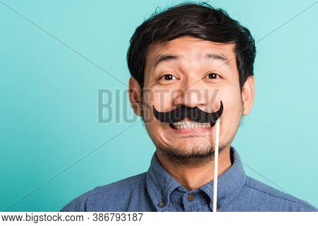 Portrait Asian Happy Handsome Man Posing He Holding A Funny Mustache Card Or Vintage Fake Moustaches