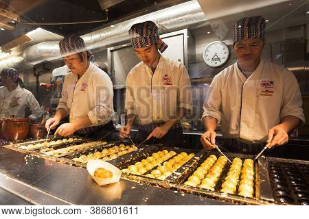 Tokyo, Japan - November 3, 2020 :japanese Chefs Are Cooking Takoyaki In The Restaurant At Akihabara,