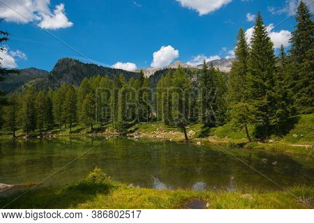Idyllic Lake In The Pass Of San Pellegrino, Val Di Fassa. View Of Trentino Dolomites In The Summer S