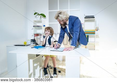 Boss And Employee. Little Boss And Mature Employee In The Office. Business People Planning Strategy