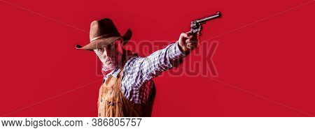Man Wearing Cowboy Hat, Gun. West, Guns. Portrait Of A Cowboy. Owboy With Weapon On Red Background