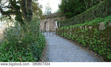 Sintra, Portugal - December 26, 2017: Walking Around Amazing Quinta Da Regaleira Garden, Portugal.