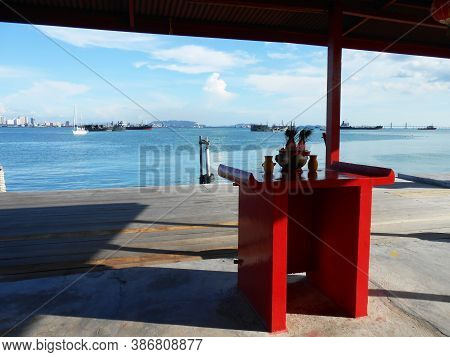 Georgetown, Penang, Malaysia, November 13, 2017: Table With Offerings On The Porch Of A Temple In Ch