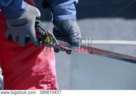 Cutting Of Metal Sheets With Powerful Industrial Hand-operated Scissors