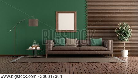 Green Living Room With Leather Sofa In Front Of A Wooden Panel - 3d Rendering