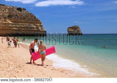 Algarve, Portugal - May 31, 2018: Beachgoers Visit Marinha Beach In Algarve Region, Portugal. Coasta