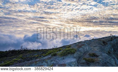 Beautiful Sky With Clouds In The Morning, Two Trekkers On Top Of The Hill, Adventure Travel Concept,