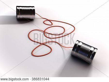 A Pair Of Homemade Toy Telephones Made From Empty Tin Cans And Connected Wth A String On An Isolated