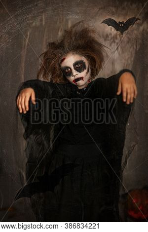 Halloween Little Girl Vampire. Halloween Vampire Kids Makeup. Wounds And Blood On The Face. Scary Fa