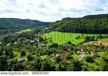 MALA SKALA,CZECH REPUBLIC - AUGUST 26, 2020: View of Mala Skala village from Vranov Castle in Bohemian paradise ( Cesky Raj ),Czechia.