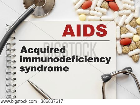 Page In Notebook With Aids Acquired Immunodeficiency Syndrome On White Background With Stethoscope A