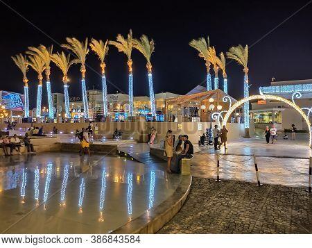 Sharm El Sheikh, Egypt - September 13, 2020: Soho Square. Luminous Palm Trees At The Entrance To Soh
