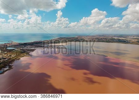 Beautiful Aerial Photo Of Salt Lake Of Torrevieja During Sunny Day Clouds Reflected In Salted Water.