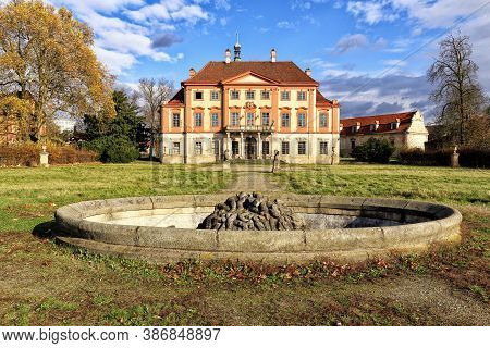 Old Abandoned Libechov Castle Builing With Empty Fountain In Nearby Park
