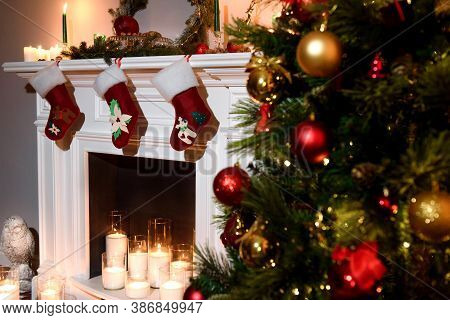 A Beautiful New Year Attributes: A Decorated Tree And A Warm Fireplace With Present Toys. Decorated