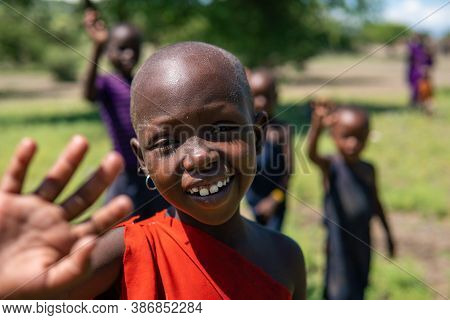 Engare Sero. Tanzania - January 2020: Indigenous Maasai In Traditional Village. Maasailand Is The Ar