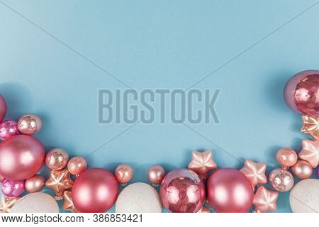 Top View Flat Lay With Various Pink And White Christmas Tree Bauble And Star Ornament At Bottom On L