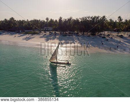 Dhow Catamaran Sail Boat Near The White Sand Beach In Paje Village On Zanzibar
