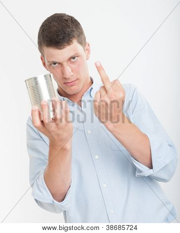 Young man holding an aluminum can and showing his middle finger