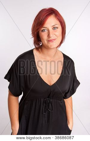 Portrait of a voluptuous red haired woman