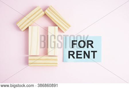 House For Rent Label On Christmas Holidays. Wooden House Symbol With Rent Tag On Blue Background. Re