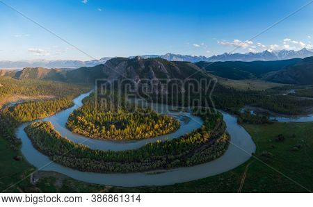 Kurai steppe and Chuya river on North-Chui ridge mountains background. Altai mountains, Russia. Aerial drone panoramic picture.