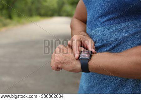 Man With Smart Watch Checking Time Interval, Distance, Heart Rate And Burnt Calories Amount In Fitne
